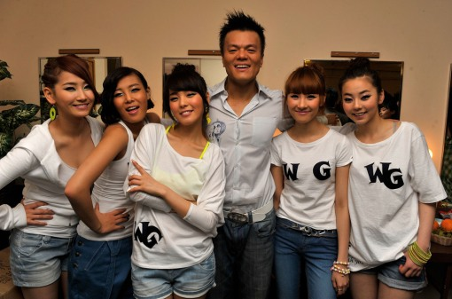 The Wonder Girls and singer JYP pose backstage after performing at the Wiltern theater on March 5, 2009 in Los Angeles, California.